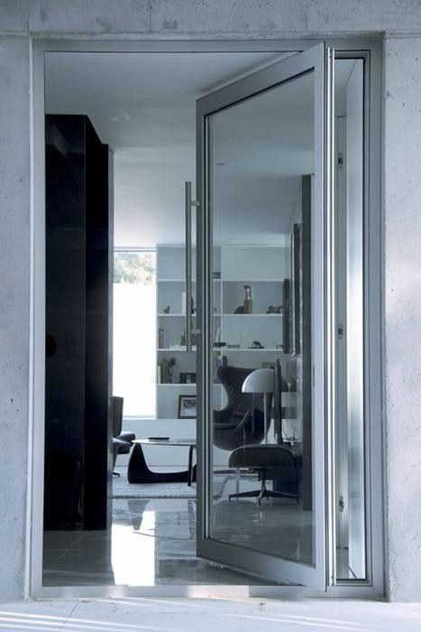 Casa Claudia: Salas de estar  por Artspazios, arquitectos e designers
