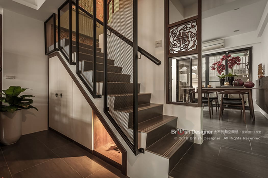 新東方-梯間:  走廊 & 玄關 by 大不列顛空間感室內裝修設計