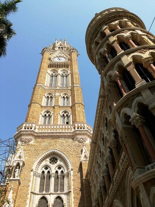 Rajabai Clock Tower and Mumbai University Library Colonial style walls & floors by Somaya and Kalappa Consultants Colonial