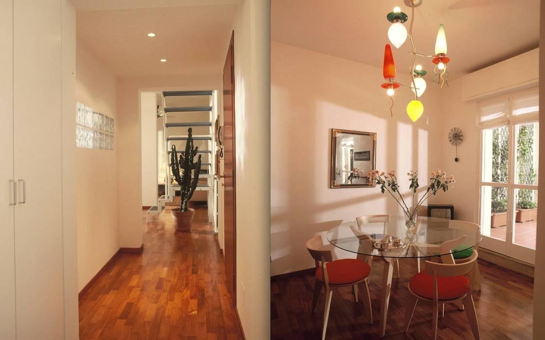 Zona pranzo con illuminazione colorata di Artemide: Sala da pranzo in stile in stile Minimalista di Fabio Carria