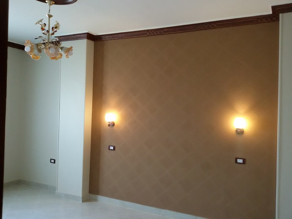 Mr. Hamdy Appartment:  غرفة المعيشة تنفيذ Etihad Constructio & Decor,