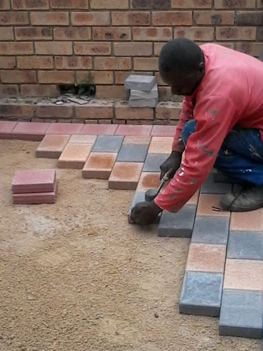 Brick Laying Industrial style houses by Nozipho Construction Industrial