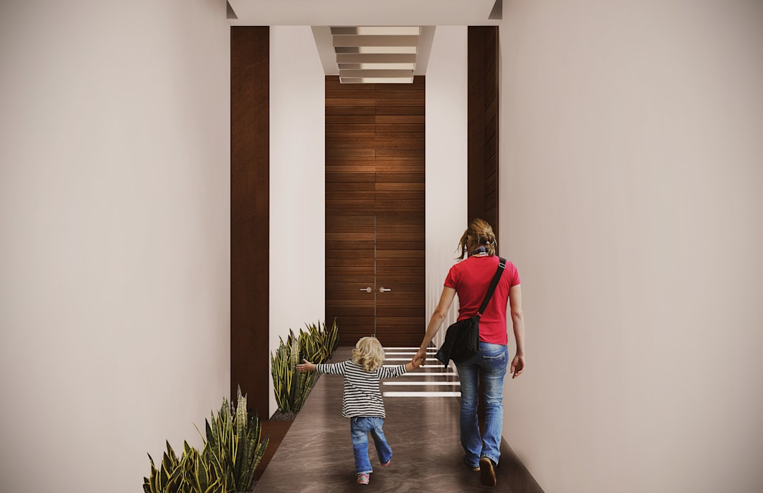 Pasillo Pasillos, vestíbulos y escaleras de estilo moderno de Estudio Volante Moderno Mármol