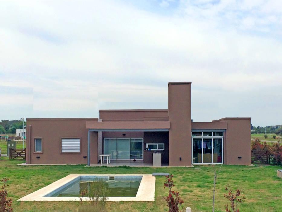 Galeria: Casas de estilo moderno por TORRETTA KESSLER Arquitectos
