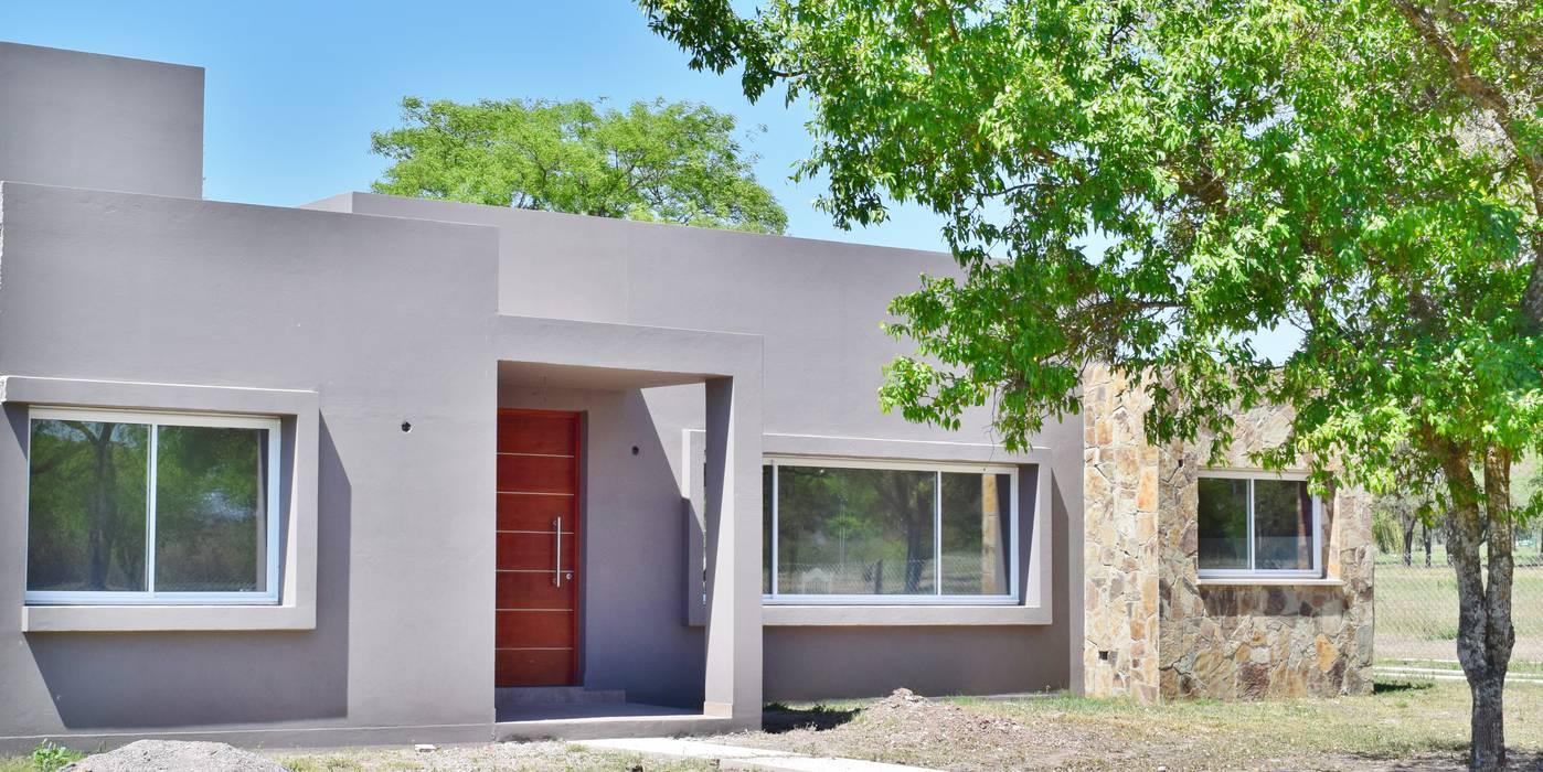 Casas de estilo  de Carlos Iriarte arquitectura,