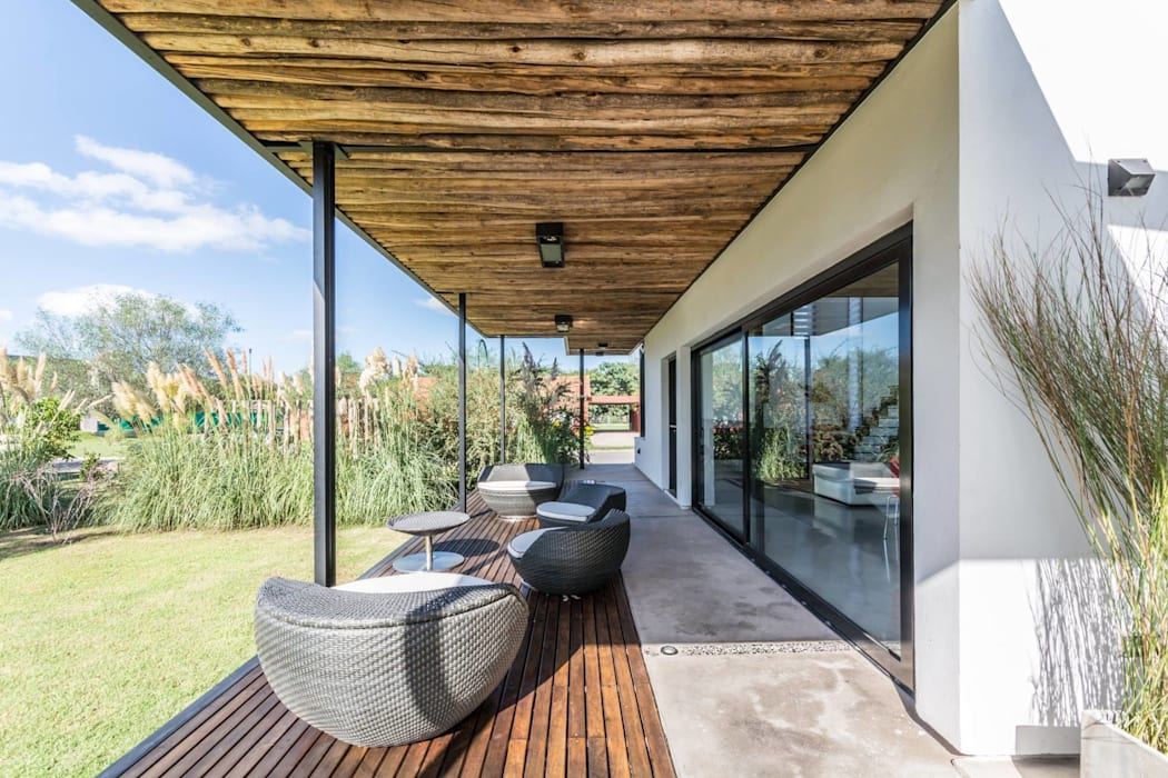 Casa VA: Jardines de estilo  por Development Architectural group