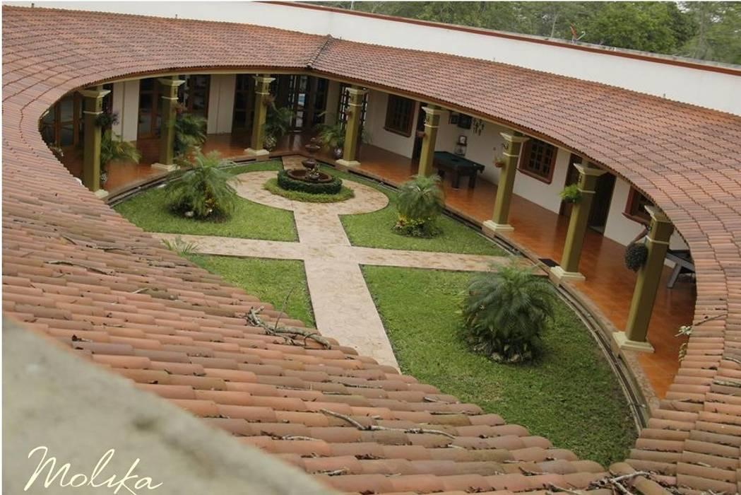 CASA CEDRO Casas de estilo colonial de homify Colonial