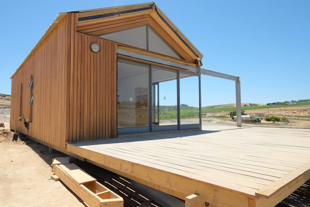50m2 Sugar Gum Cladded home with decking - work in progress.:  Houses by Greenpods,