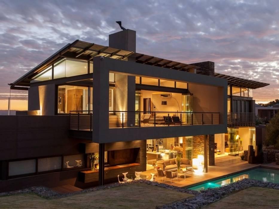 Modern House Designs Modern houses by homify Modern