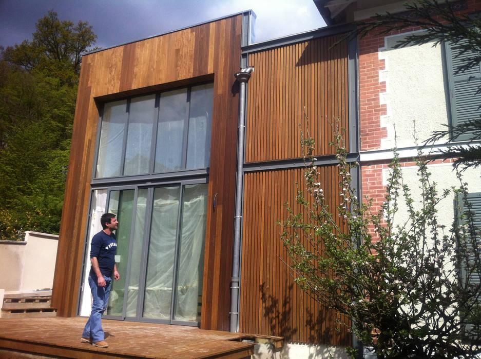 façade jardin: Maisons de style  par Eric Rechsteiner