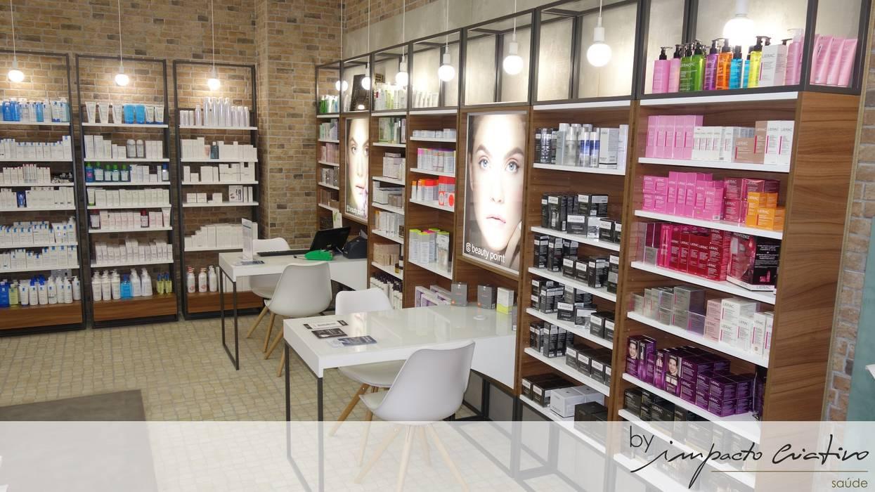 Chemist Store - Olivais: Espaços comerciais  por Impacto Criativo
