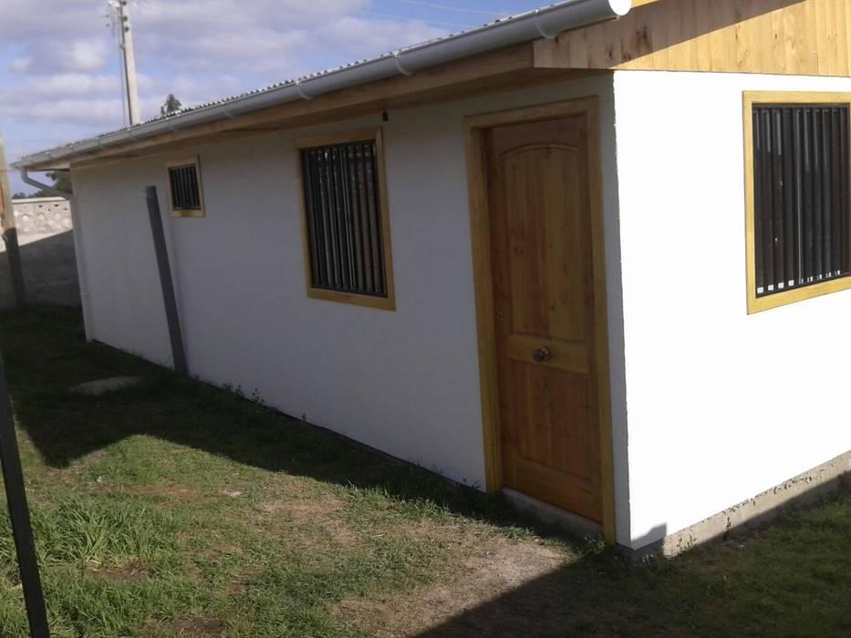 Casa Prefabricada 36 mt2.   Forrada: Casas de estilo  por Construcciones JYR