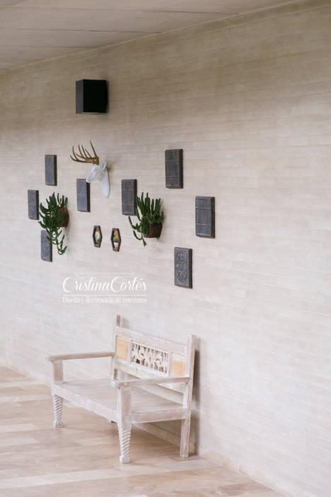 Pasillo Cristina Cortés Diseño y Decoración Vestíbulos, pasillos y escalerasSillones