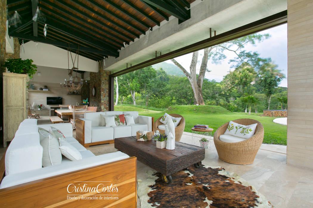 Sala principal de día: Salones de estilo  por Cristina Cortés Diseño y Decoración
