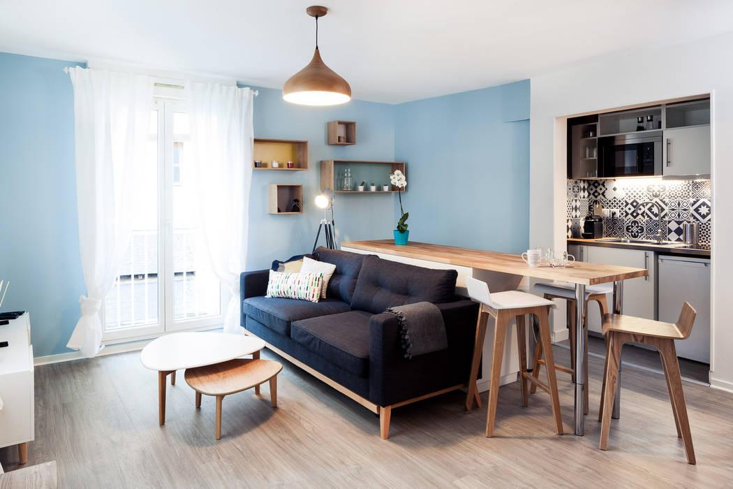 Rénovation complète d'un appartement de 30m²: Salon de style  par MadaM Architecture