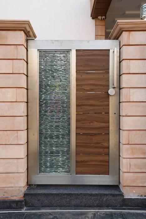Casas de estilo  por RAVI - NUPUR ARCHITECTS, Moderno Aluminio/Cinc