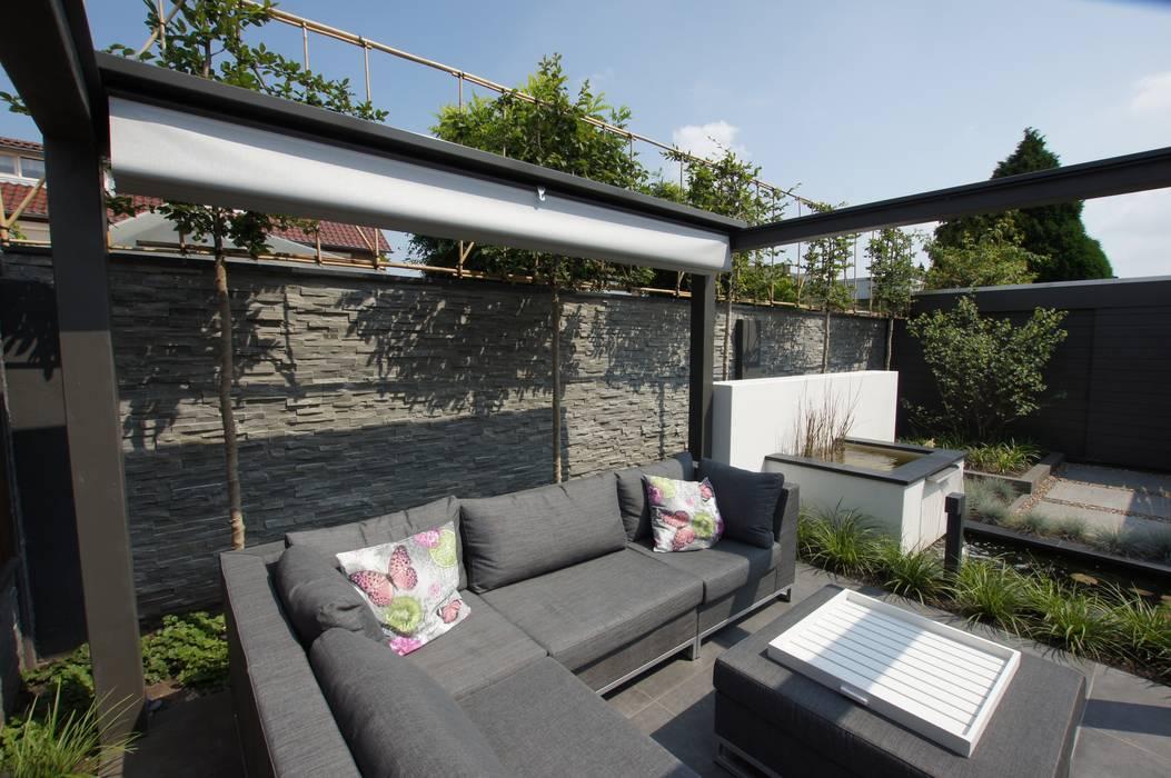 Jardines de estilo  por GroenerGras Hoveniers Amsterdam, Moderno