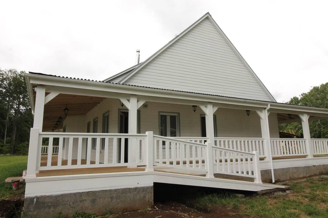 Casa Hott: Casas de estilo  por Kanda arquitectos