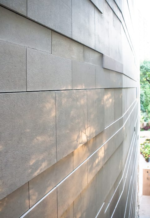 Shadow on Facade Modern houses by Sensearchitects_Limited Modern Stone