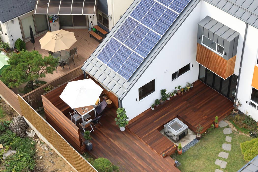 Jardines de estilo moderno de 주택설계전문 디자인그룹 홈스타일토토 Moderno Madera Acabado en madera