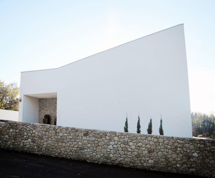 Alçado Casa A+ Casas minimalistas por Oficina de Conceitos Minimalista Granito