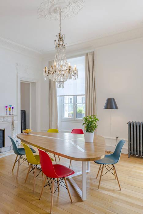 Un Haussmannien décoré Salle à manger classique par Dominique Marcon Classique