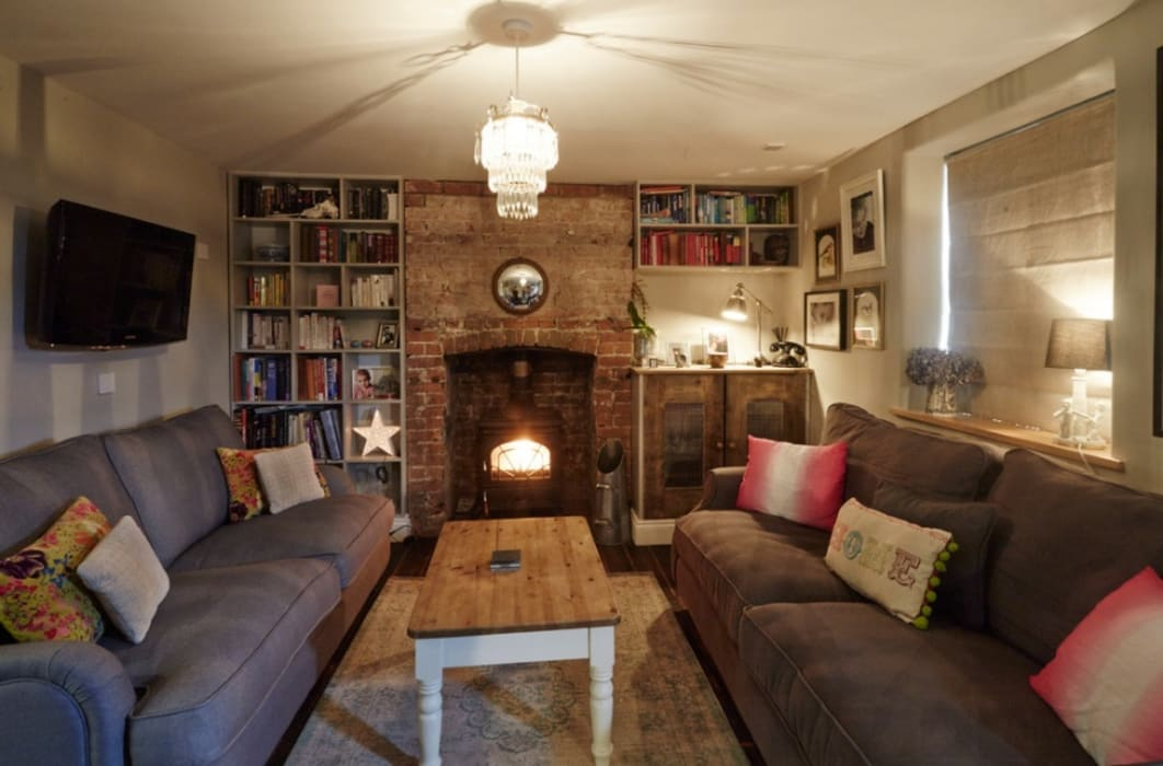 Wren Cottage: country Living room by Askew Cavanna Architects
