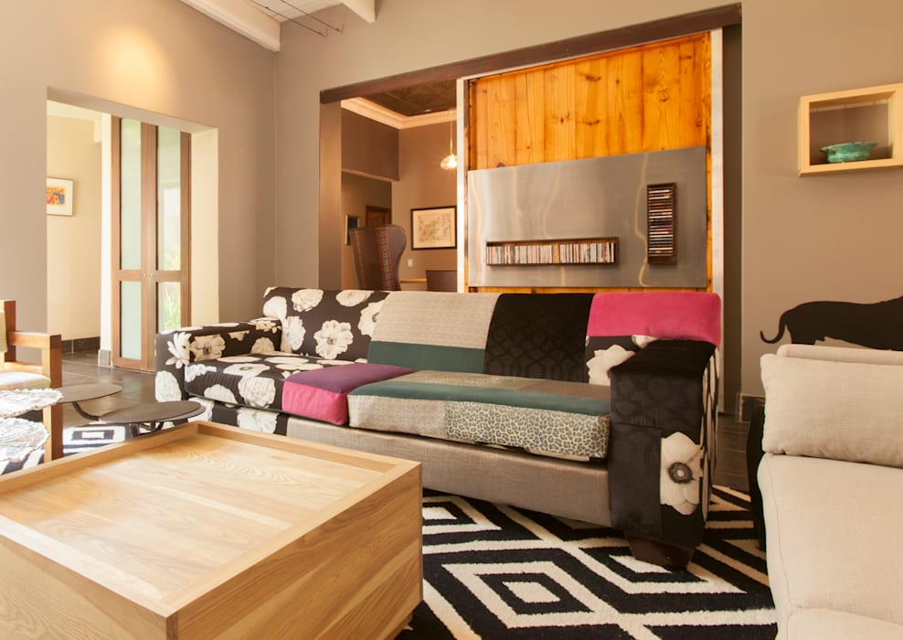 Living room by Redesign Interiors, Eclectic