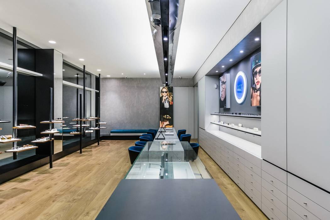 3 Lojas e Espaços comerciais modernos por XYZ Arquitectos Associados Moderno