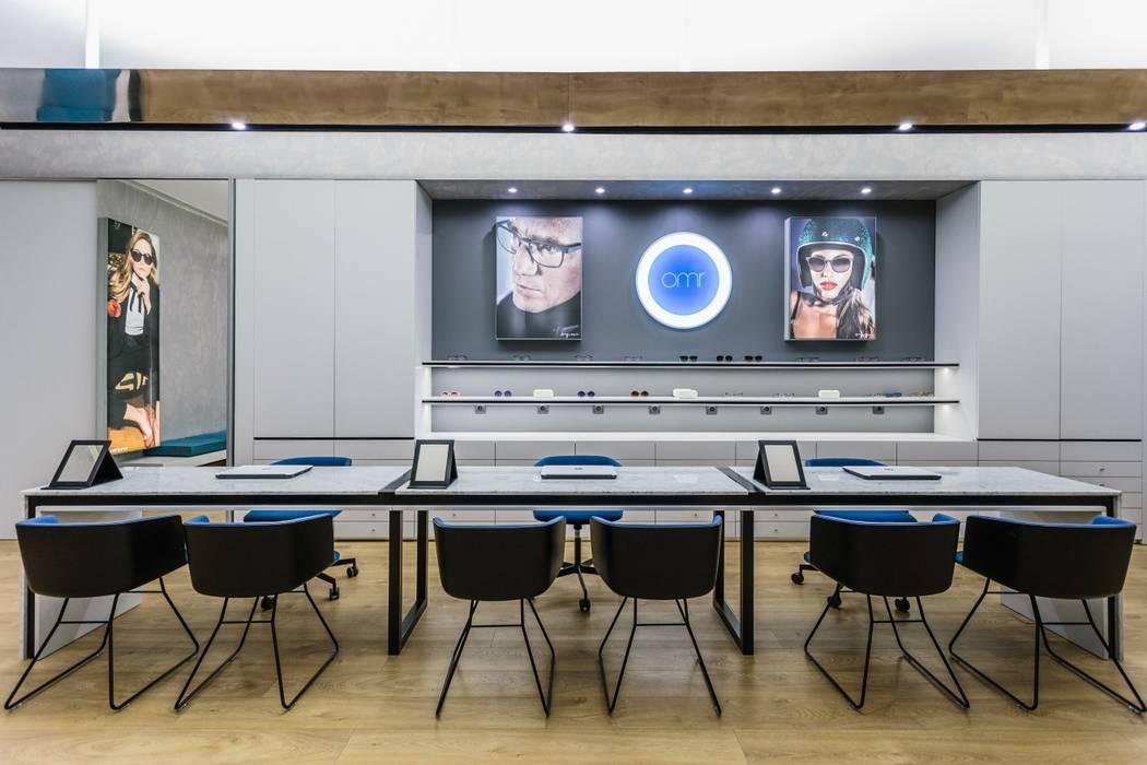 6: Lojas e espaços comerciais  por XYZ Arquitectos Associados,