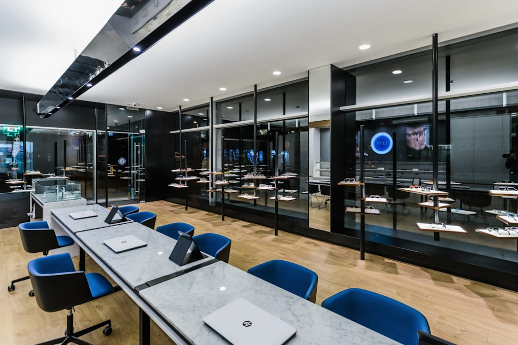 11: Lojas e espaços comerciais  por XYZ Arquitectos Associados,