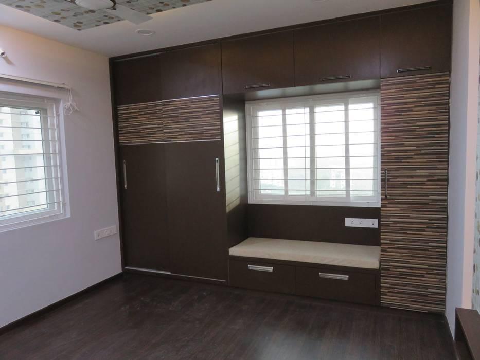wardrobe & settee in master bedroom:  Bedroom by Bluebell Interiors,Modern Plywood
