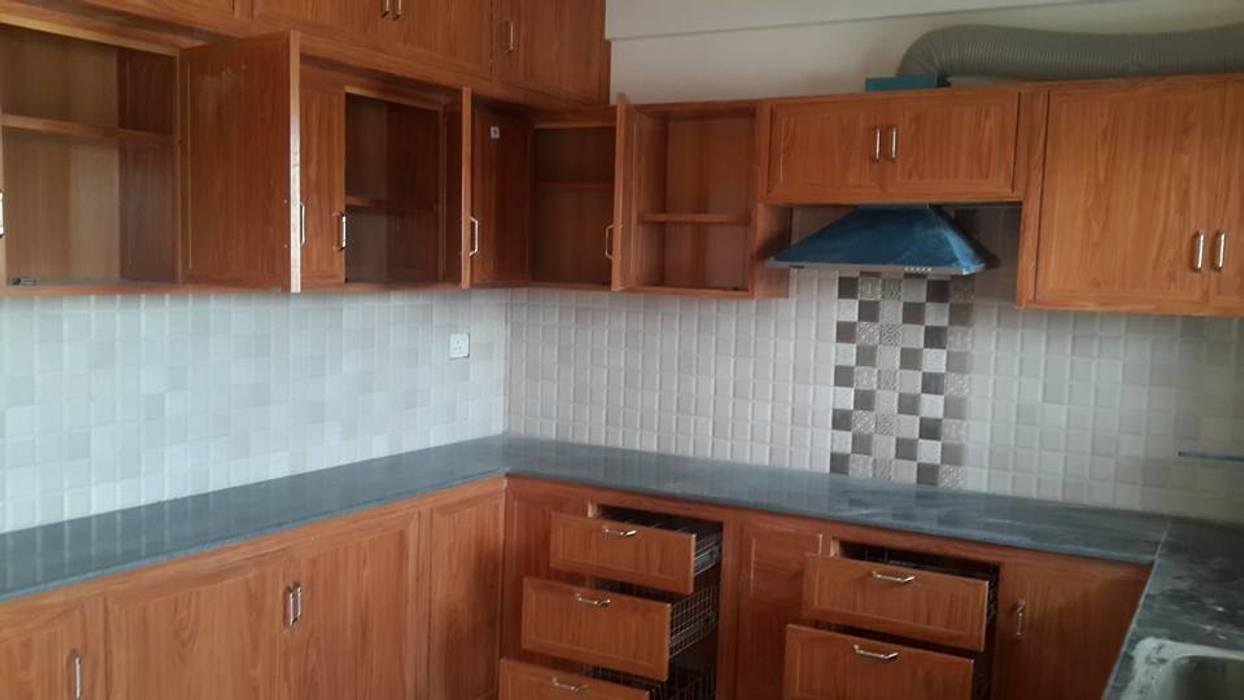 pvc modular kitchen in hosur pvc kitchen cabinets in hosur balabharathi balabharathi pvc interior design KitchenCabinets & shelves Plywood Wood effect