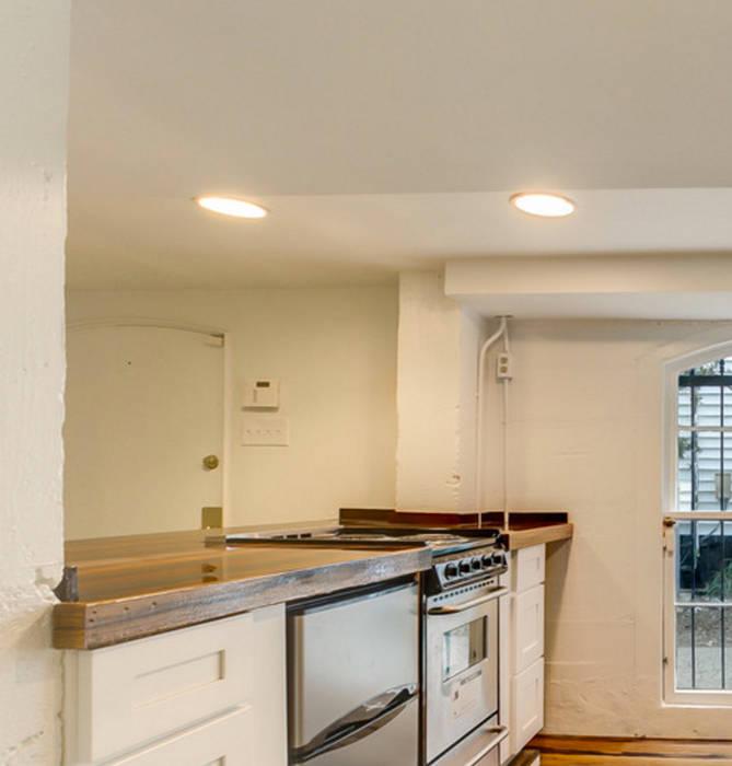 Nashville Avenue Residence, New Orleans:  Kitchen by studioWTA