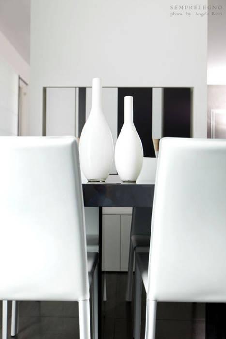Set tavolo eseguito su misura per una zona pranzo moderna for Zona pranzo design