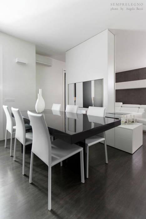 Cucina su misura con zona pranzo e soggiorno design a vista ...