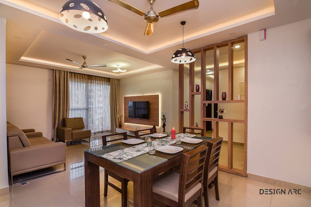 Living Room Interior Apartment Bangalore:  Living room by Design Arc Interiors