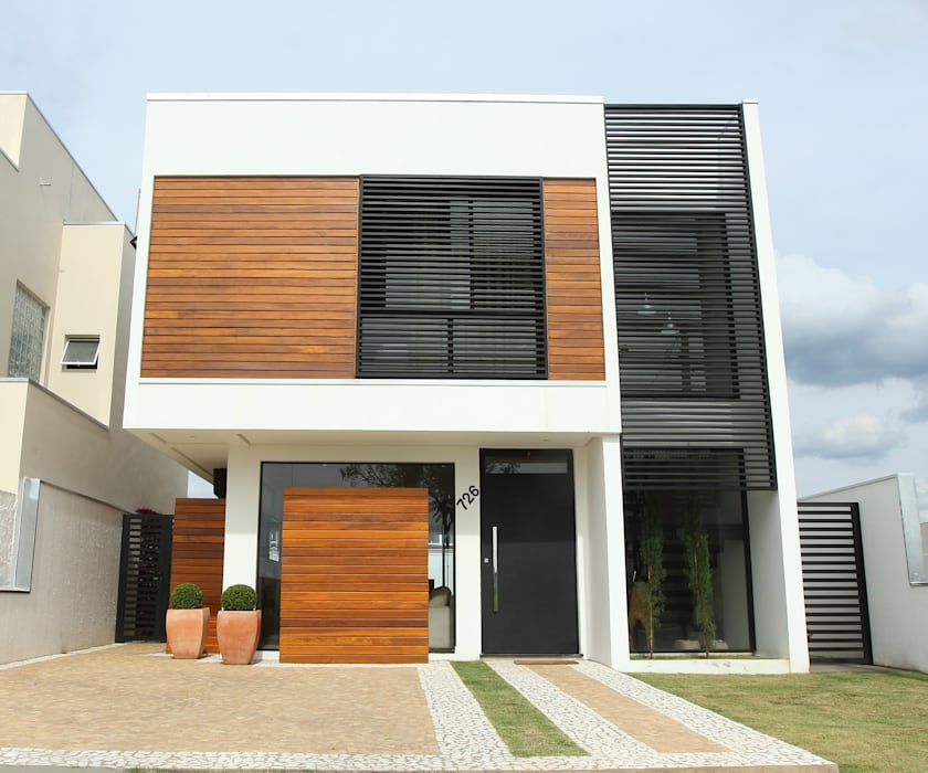 Rumah oleh Taguá Arquitetura, Modern Kayu Wood effect