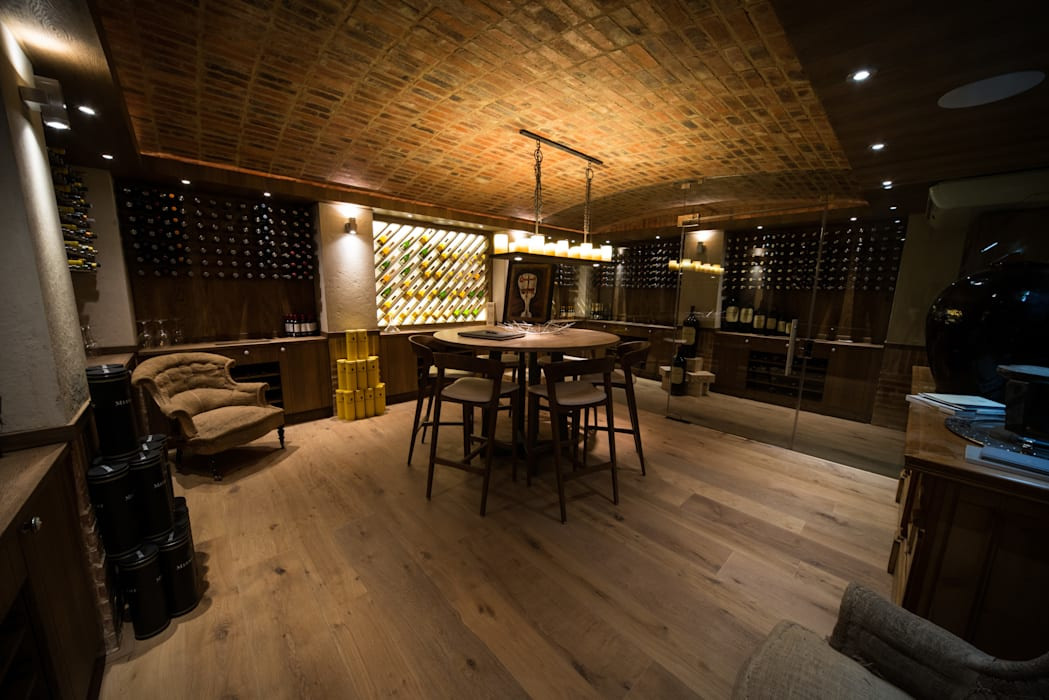Upmarket home in Johannesburg:  Wine cellar by Kim H Interior Design