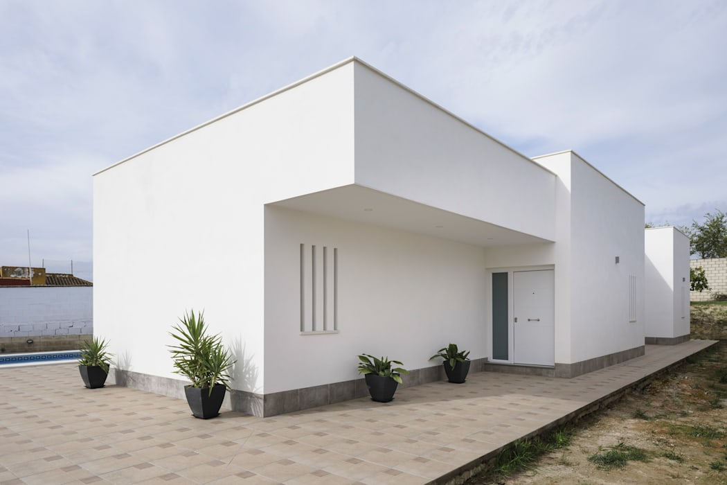 Casa Miranda: Casas de estilo  de FAQ arquitectura,