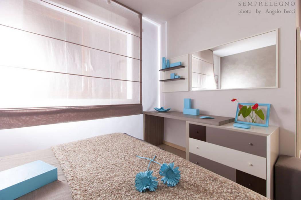 Letto E Cassettiera : Stanza da letto arredata su misura con mobili e cassettiera