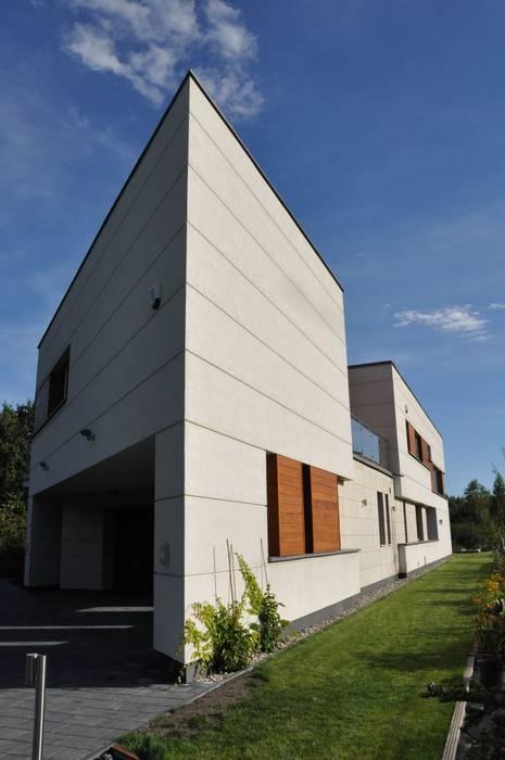 Modern houses by BECZAK / BECZAK / ARCHITEKCI Modern