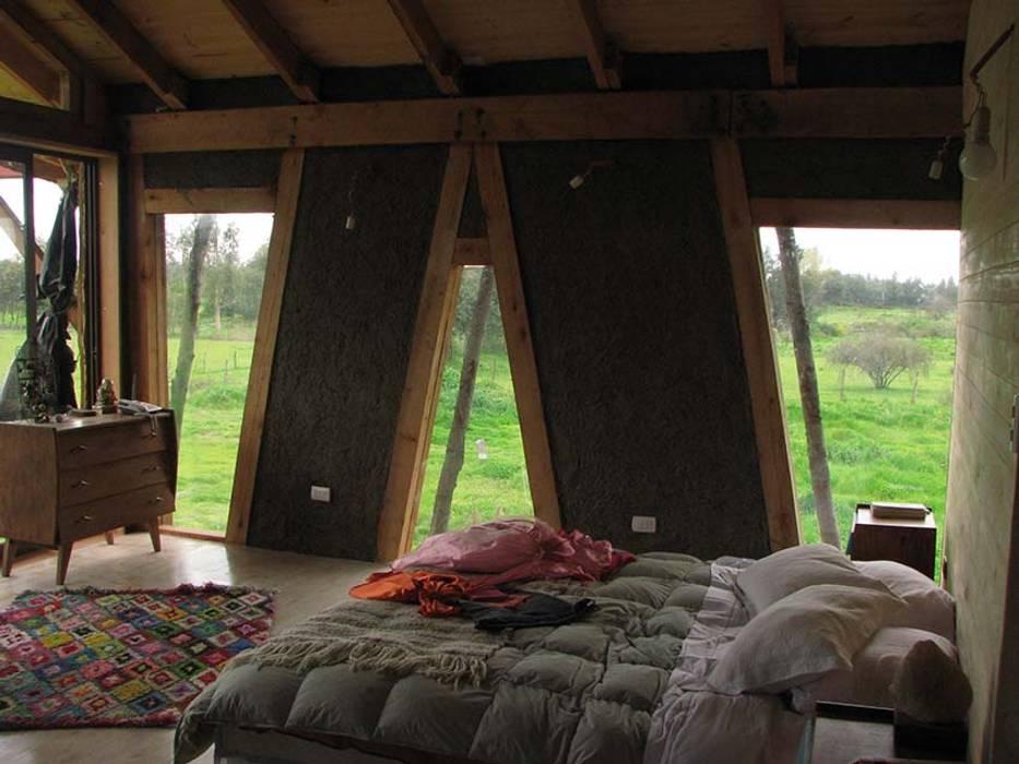 Camera da letto in stile  di Estudio Terra Arquitectura & Patrimonio