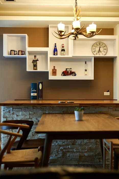 櫃門線條隱隱透露簡約設計細節:  餐廳 by 青瓷設計工程有限公司