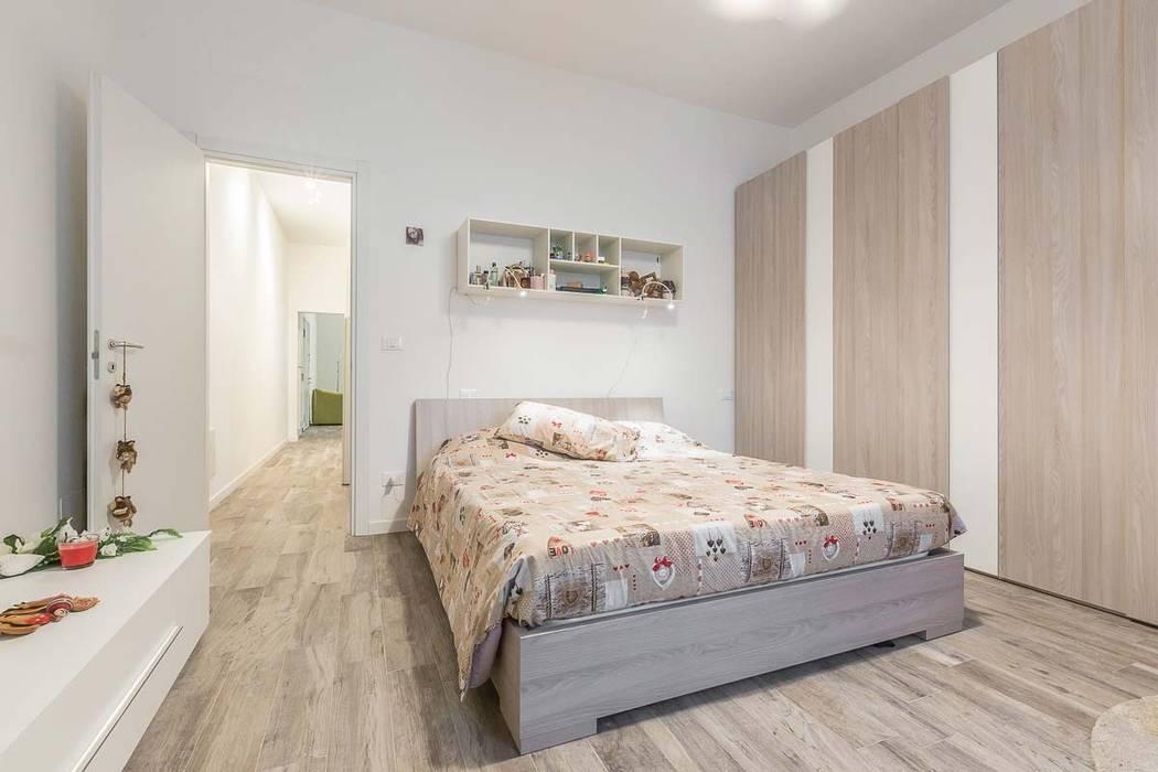 Camera da letto matrimoniale camera da letto in stile di for Ristrutturare la camera da letto