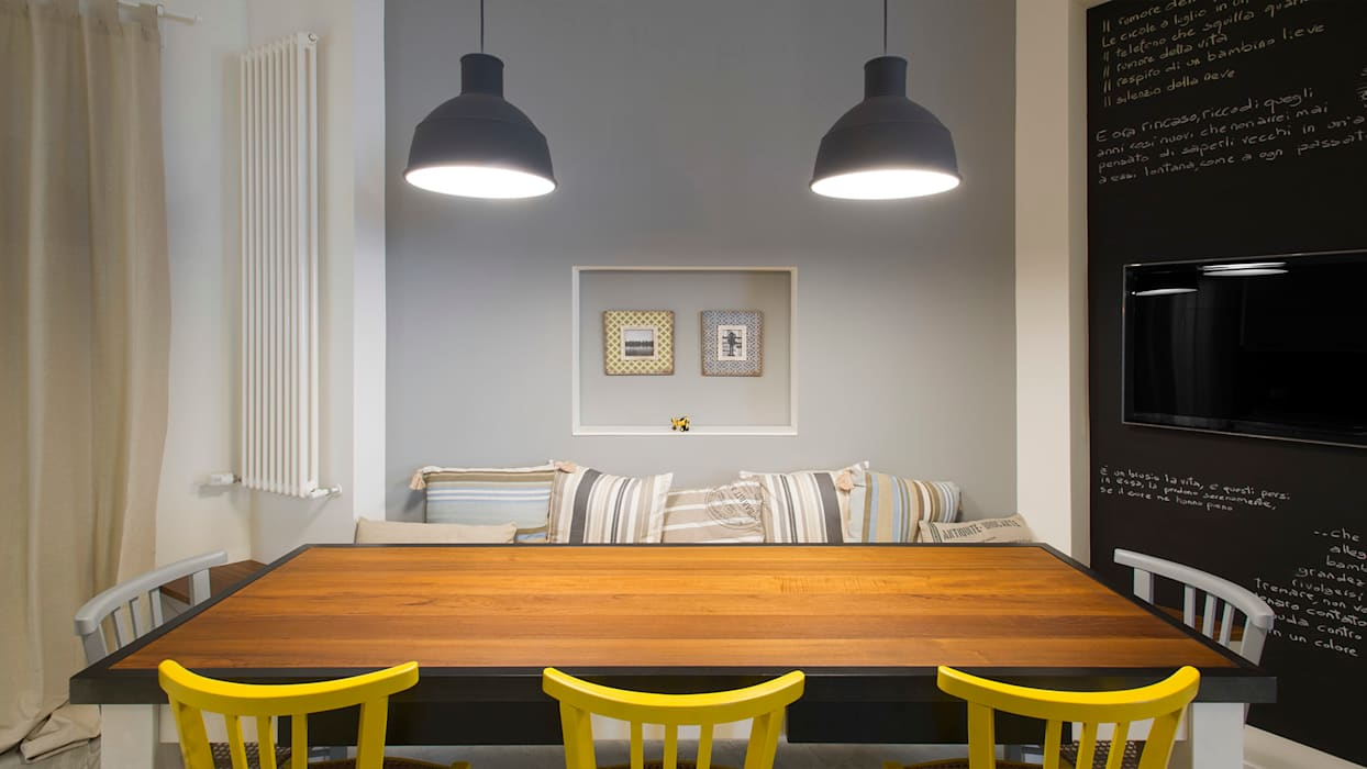 Industrial style dining room by Archifacturing Industrial