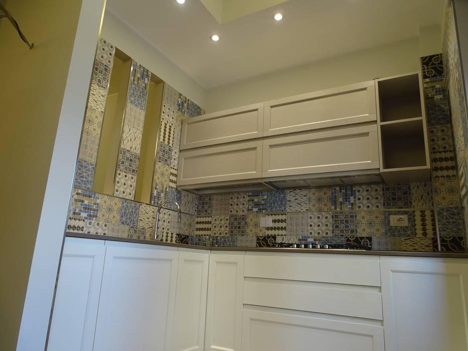 Angolo cottura ad effetto: Cucina in stile in stile Eclettico di NicArch
