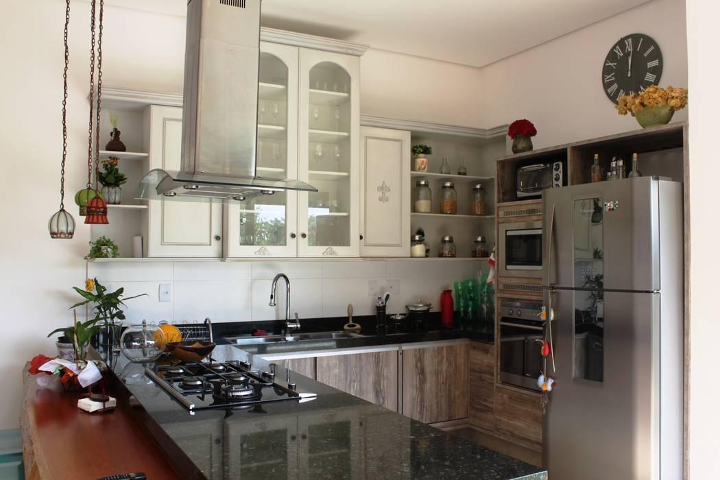 Cozinha gourmet: Cozinhas  por Barros e Zanolini Arquitetura e construção,Rústico