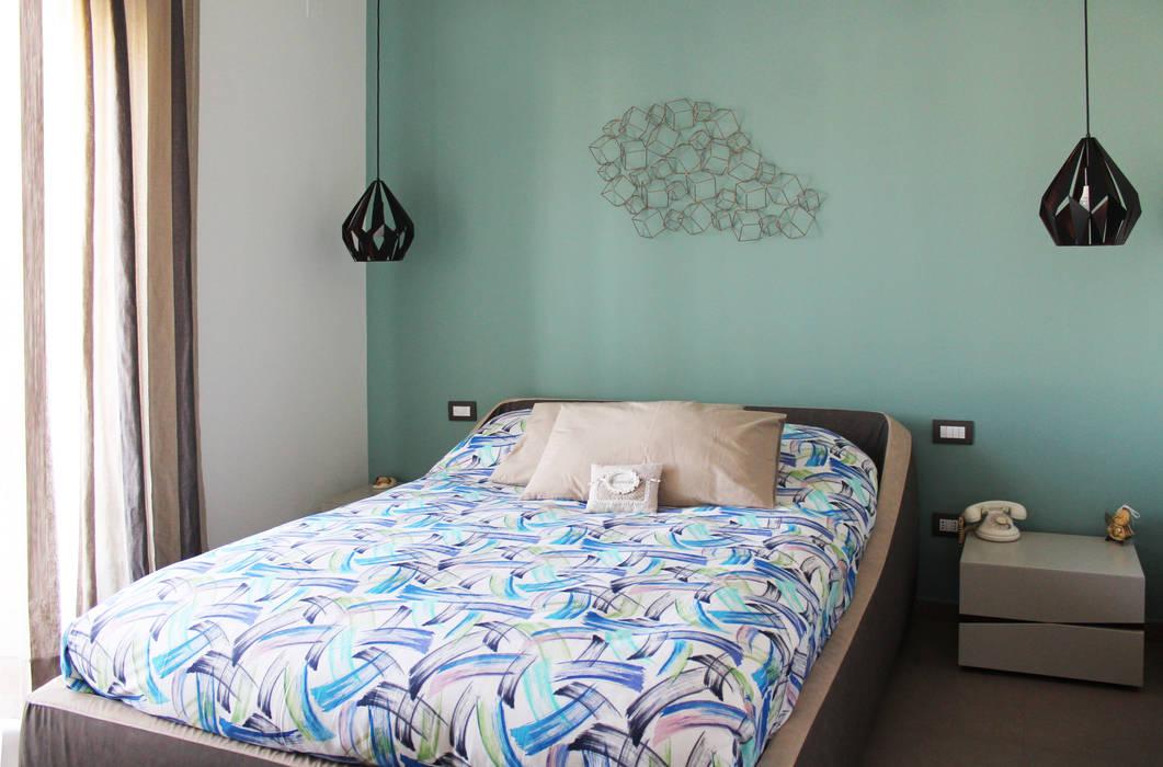 La camera da letto Camera da letto moderna di Arch. Rosalba Di Maio Moderno