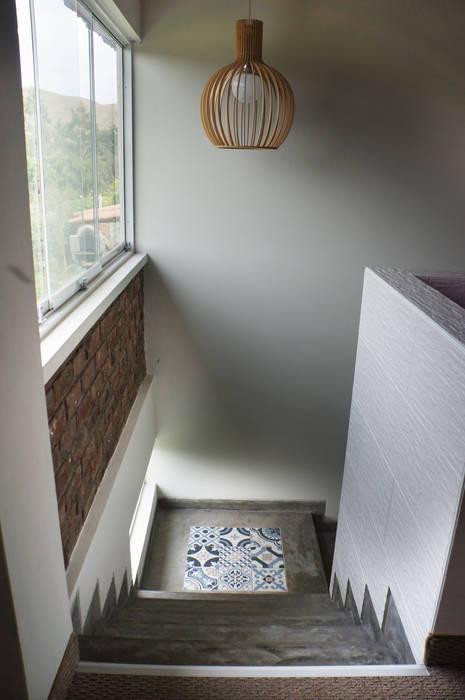 Couloir et hall d'entrée de style  par malu goni, Rustique